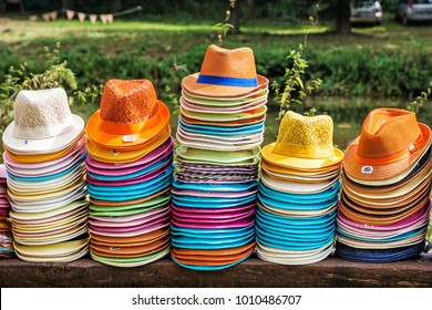 Colorful collection of hats in the shop. Summer fashion.