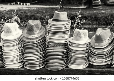 Colorful collection of hats in the shop. Summer fashion. Black and white photo.