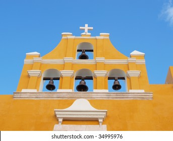 Colorful colonial church with bells in the central part of the city of Campeche, Yucatan, Mexico.