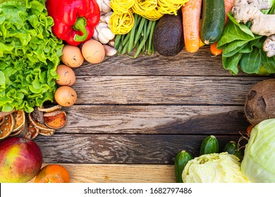 Colorful composition of assorted vegetables: tomato, egg,garlic,lemon,salad,mango,onion,lettuce, Studio photography. No people. Healthy eating concept. Organic and fresh food concept.on  background