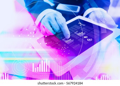 Colorful concept of a businessman working with digital tablet at office with virtual interface