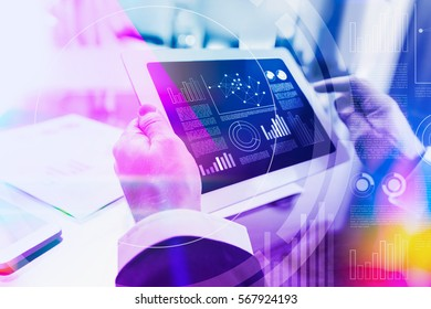 Colorful concept of a businessman working with digital tablet at office
