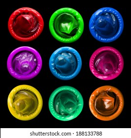 Colorful condoms isolated on black background