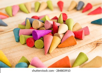 Colorful cone shape incense stick with aroma scent grouping in the middle of the other..