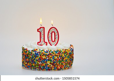 Colorful Confetti Cake With Lit Candles for 10th Birthday or tenth Anniversary