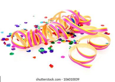 Colorful confetti and party streamer over white background