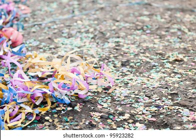 colorful confetti and streamers at the street after Carnival Parade (shallow DOF)