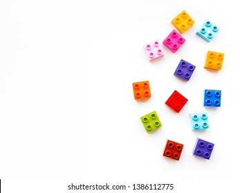 Colorful constructor blocks. Toy bricks lyingwithout order. Place for text among multicolored toy details. Place for text.