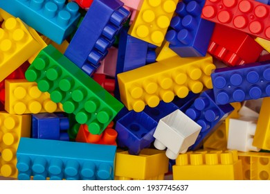 A colorful constructor set for children which lies on the plastic container