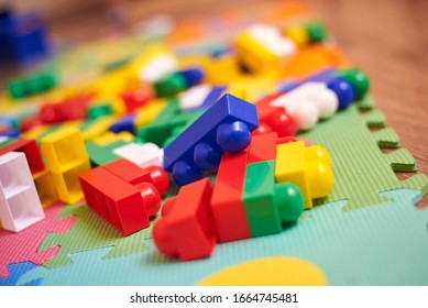 A colorful constructor set, which lies on the floor of a house, close-up. Educational games for children.
