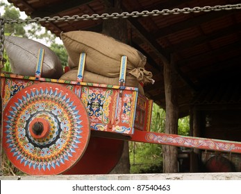 Colorful Costa Rican Ox Cart loaded with coffee bags