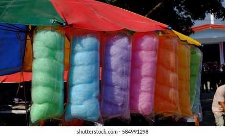 colorful cotton candy miniatures on background with texture