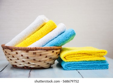 Colorful cotton towels in a basket
