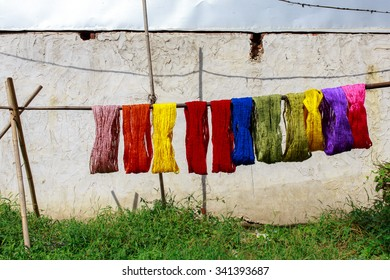 Colorful cotton yarn drying on a stick , in Myanmar , Asia