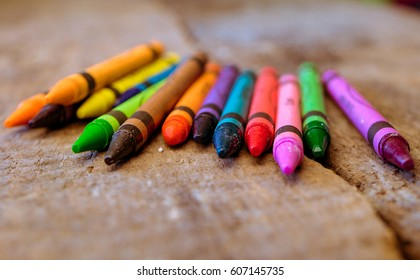 Colorful crayon color on wooden background
