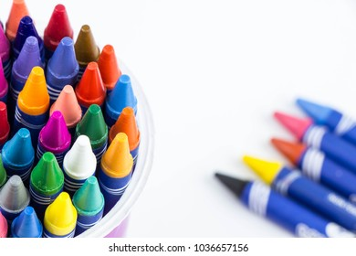 Colorful crayons in cup,white background,close up