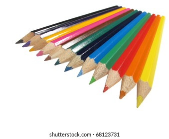 Colorful crayons in the row-perspective view, isolated over white background