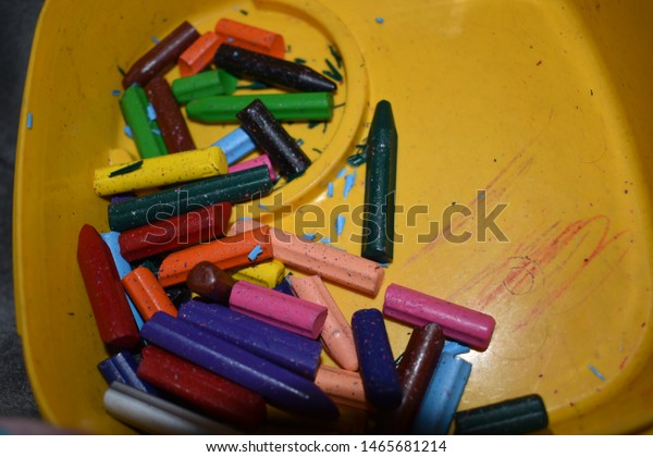colorful crayons in yellow box