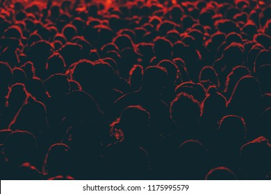 Colorful crowd of people of a big music festival in a stage lights as a beautiful background