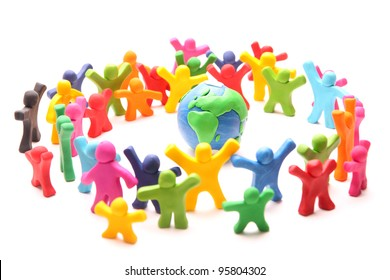 colorful crowd standing around planet earth to protect it