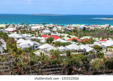 A colorful crowded view of homes on the island of St Maarten in the Caribbean Sea.