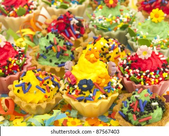 colorful cup cakes with confetti