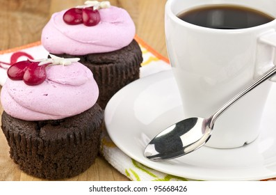 colorful cupcakes and a cup of coffee coffee