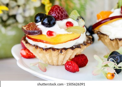 Colorful cupcakes with fresh fruits.