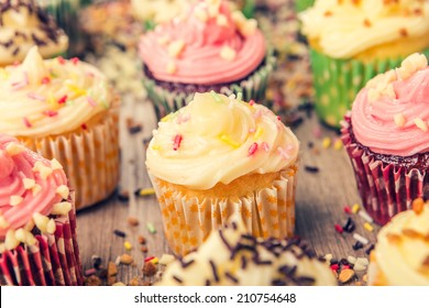 colorful cupcakes frosted with a variety of frosting flavors