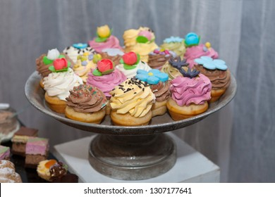 Colorful cupcakes, junk food confectionery and eating concept close up of cupcakes