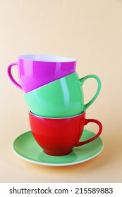 Colorful cups on color background