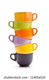 Colorful cups tower on white background