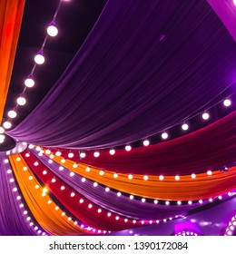 Colorful curtain and light bulb decorations. Circus party decorations.