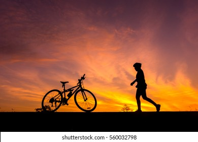 colorful of cyclist and Bicycle silhouettes on the dark background of sunsets