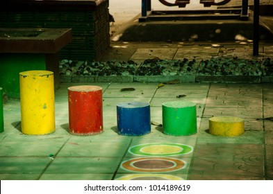 colorful cylinder cement shape on the kid playground of kindergarten school