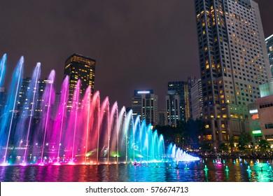 Colorful dancing fontain in night city atmocphere in KLCC Park, Kuala Lumpur Malaysia.