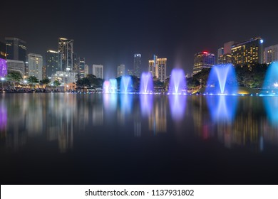 Colorful dancing fontains at night in KLCC Park, Kuala Lumpur Malaysia
