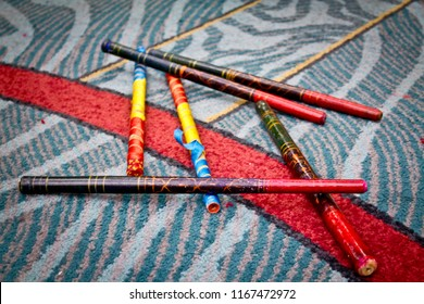 Colorful Dandiya Sticks Lying on the Carpet during a Navratri Garba Indian Festival Event in San Diego, California, USA