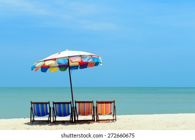 Colorful deck chairs with umbrella at the summer beach