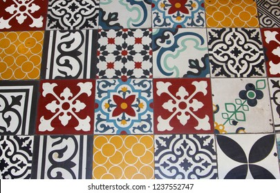 Colorful decorated antique floor tiles with floral patterns in Portuguese style, cafe restaurant, Hanoi, Vietnam