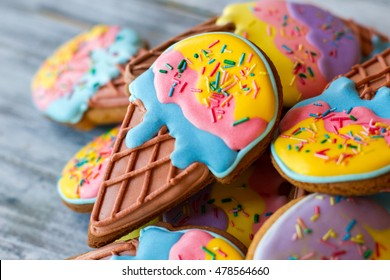 Colorful decorated cookies. Pile of biscuits with glaze. Healthy sweets for kids. Desserts from crispy dough.