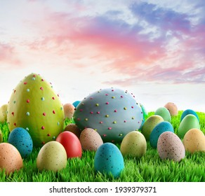 Colorful decorated eggs in the grass with sky in background