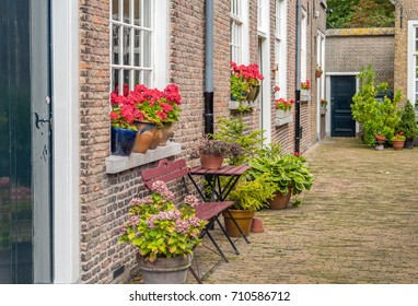 Colorful decorated facades in the beguinage in the Dutch city of Breda. This oldest beguinage in the Netherlands was grounded in 1267. The garden is open to public.