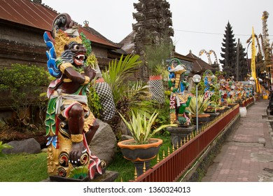 colorful decorated temple entrance with watchman figures and all kind of garden and temple ornaments