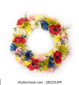Colorful decorative artificial flowers on white
