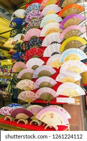 Colorful, decorative japanese fans for sale in a shop in Japan