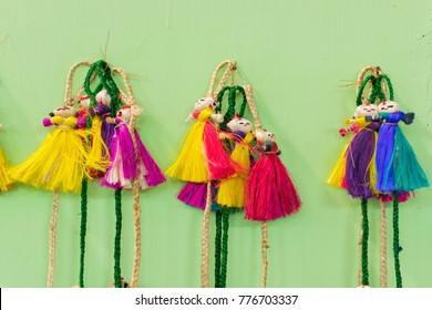 Colorful decorative wall hangings, dolls made of jute, handicrafts on display with white background during the Handicraft Fair in Kolkata - the biggest handicrafts fair in Asia.