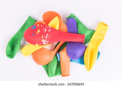 Colorful deflated balloons on white background