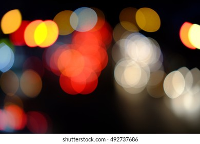 Colorful defocused bokeh lights background. Festive background with natural bokeh. Abstract blur background.