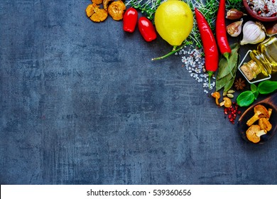 Colorful delicious ingredients for healthy cooking or salad making on slate vintage background. Bio Healthy food, herbs and spices. Organic vegetables on slate. Cooking, diet, vegetarian food concept.